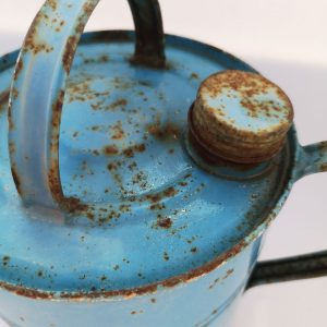 vintage blue french watering can closeup