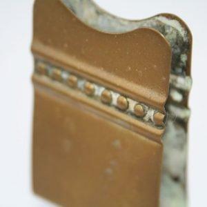 brass napkin holder close